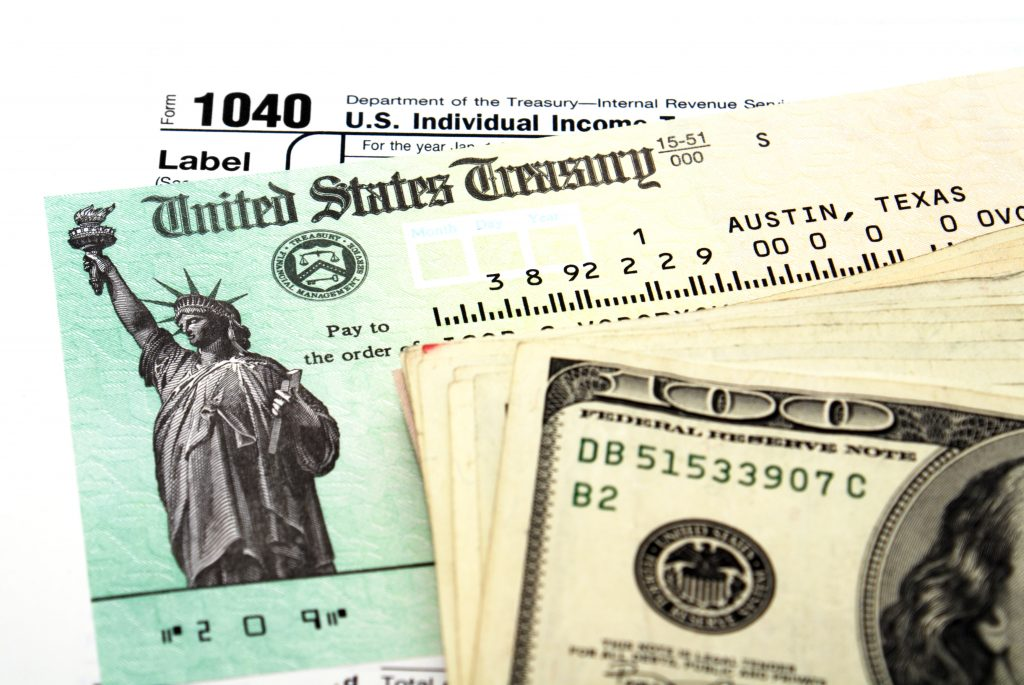 Tax return check and money